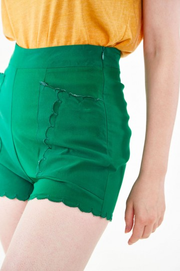 High waisted green shorts with embroidered scallop pocket detail